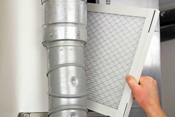 person changing filter to reduce dust