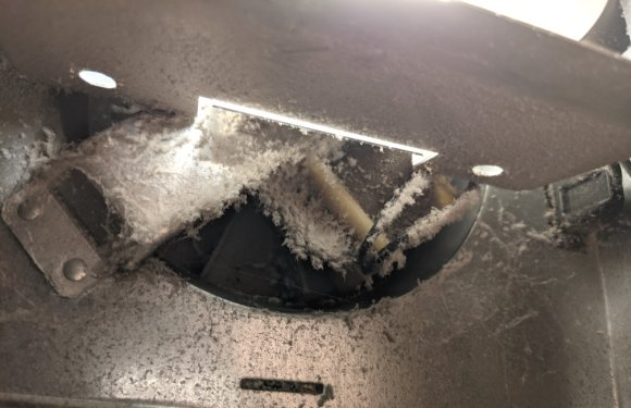 exhaust fan in bathroom covered in dust